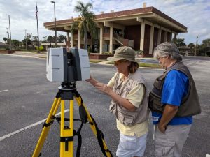 Dr. Lori C. Walters and Ms. Michelle Adams scanning the Leedy Bank