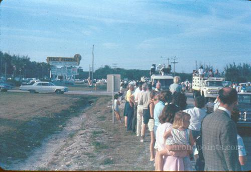 Residents in front of Glass Bank for Gemini 3 astronaut parade.