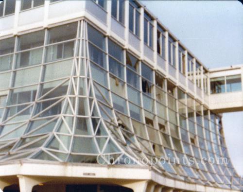North facade of building revealing tornado damage to glass - circa 1978